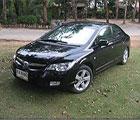 Car Hire - black Honda saloon car